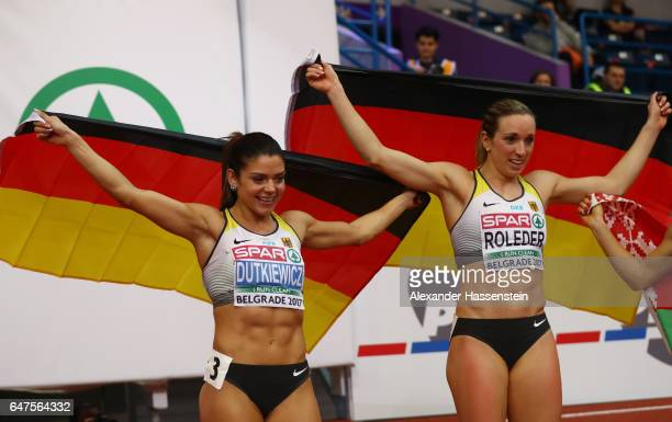 Bronze medalist Pamela Dutkiewicz of Germany and gold medalist Cindy Roleder of Germany celebrate following the Women's 60 metres hurdles final on...