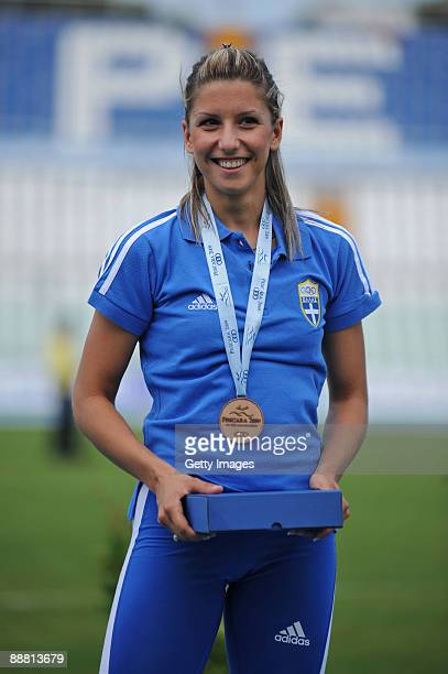 Bronze medalist Paraskevi Papachristou of Greece poses for the photographers after the Women's Triple Jump Final during the XVI Mediterranean Games...