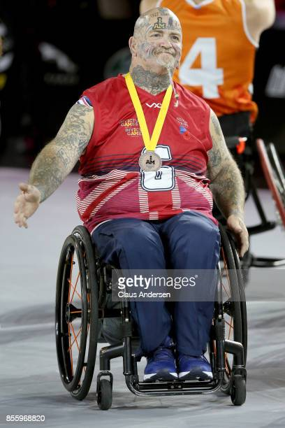 Bronze medalist Paul Guest of the United Kingdom pose on the podium at the medal ceremony for the Wheelchair Basketball Final Gold match during the...
