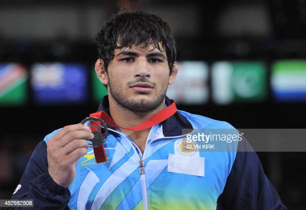 Bronze medalist Pawan Kumar of India in the Men's Freestyle 86kg Freestyle Wrestling Gold medal match at the SECC 2014 Commonwealth Games in Glasgow...