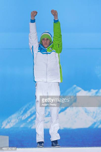 Bronze medalist Peter Prevc of Slovenia celebrates on the podium during the medal ceremony for the Men's Large Hill Individual on day 9 of the Sochi...
