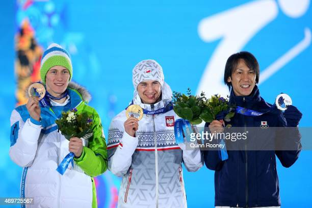 Bronze medalist Peter Prevc of Slovenia gold medalist Kamil Stoch of Poland and silver medalist Noriaki Kasai of Japan celebrate on the podium during...