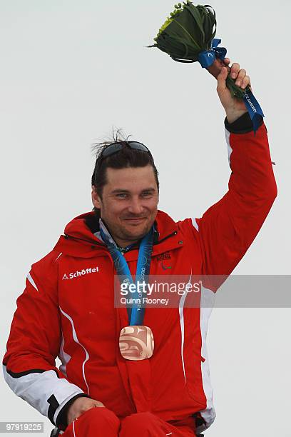 Bronze medalist Philipp Bonadimann of Austria celebrates at the medal ceremony for the Men's Sitting Super Combined during Day 9 of the 2010...