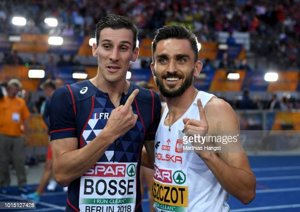 Bronze medalist PierreAmbroise Bosse of France and gold medalist Adam Kszczot of Poland celebrate winning their respective medals after the Men's...