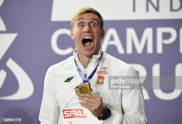 Bronze medalist Piotr Lisek of Poland celebrates during the medal ceremony for Men's Pole Vault final during the second session on Day 3 of the...