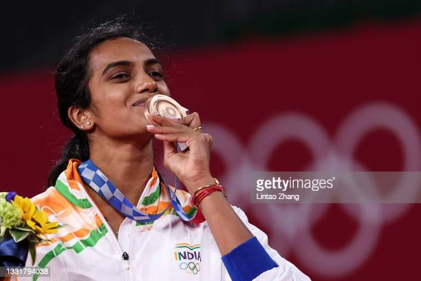 Bronze medalist Pusarla V. Sindhu of Team India kisses her medal on the podium during the medal ceremony for the Women's Singles badminton event on...