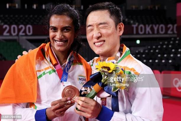 Bronze medalist Pusarla V. Sindhu of Team India poses for camera with her coach Park Tae-sang during the medal ceremony for the Women's Singles...