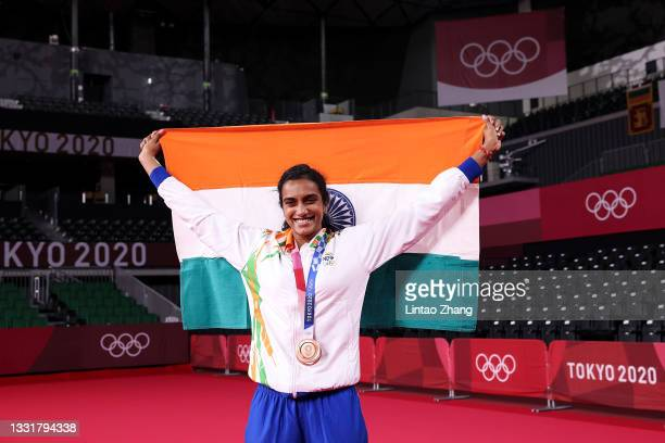 Bronze medalist Pusarla V. Sindhu of Team India poses for camera with national flag of Indian during the medal ceremony for the Women's Singles...