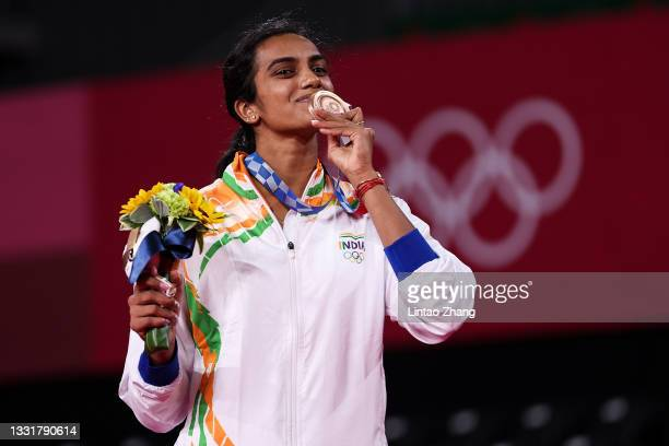 Bronze medalist Pusarla V. Sindhu of Team India poses on the podium during the medal ceremony for the Women's Singles badminton event on day nine of...