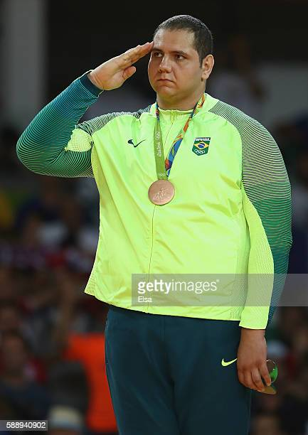 Bronze medalist Rafael Silva of Brazil celebrates on the podium during the Men's 100kg Judo contest on Day 7 of the Rio 2016 Olympic Games at Carioca...