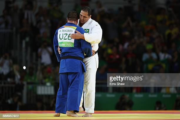 Bronze medalist Rafael Silva of Brazil hugs Abdullo Tangriev of Uzbekistan during the Men's 100kg Judo contest on Day 7 of the Rio 2016 Olympic Games...