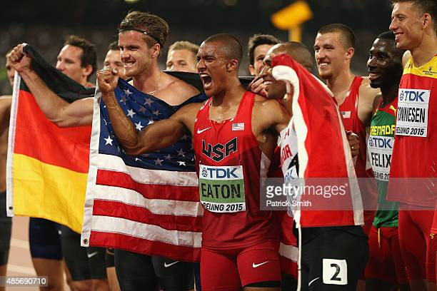 Bronze medalist Rico Freimuth of Germany gold medalist Ashton Eaton of the United States and silver medalist Damian Warner of Canada celebrate after...