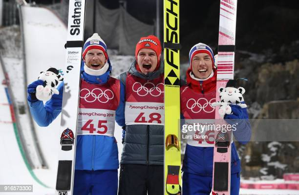 Bronze medalist Robert Johansson of Norway gold medalist Andreas Wellinger of Germany and silver medalist Johann Andre Forfang of Norway celebrate...