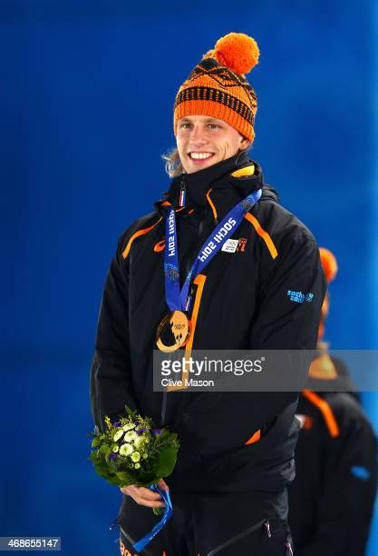 Bronze medalist Ronald Mulder of the Netherlands celebrates during the medal ceremony for the Men's 500m Speed Skating on day 4 of the Sochi 2014...