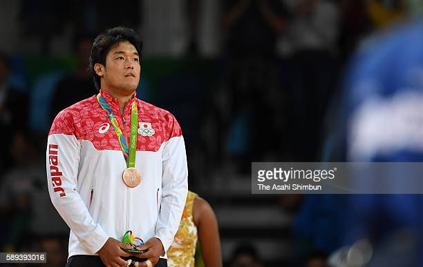 Bronze medalist Ryunosuke Haga of Japan stands on the podium at the medal ceremony for the men's 100kg on Day 6 of the 2016 Rio Olympics at Carioca...