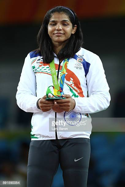 Bronze medalist Sakshi Malik of India stands during the medal ceremony after the Women's Freestyle 58 kg competition on Day 12 of the Rio 2016...