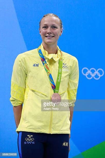 Bronze medalist Sarah Sjostrom of Sweden celebrates on the podium during the medal ceremony for the Women's 100m Freestyle Final on Day 6 of the Rio...