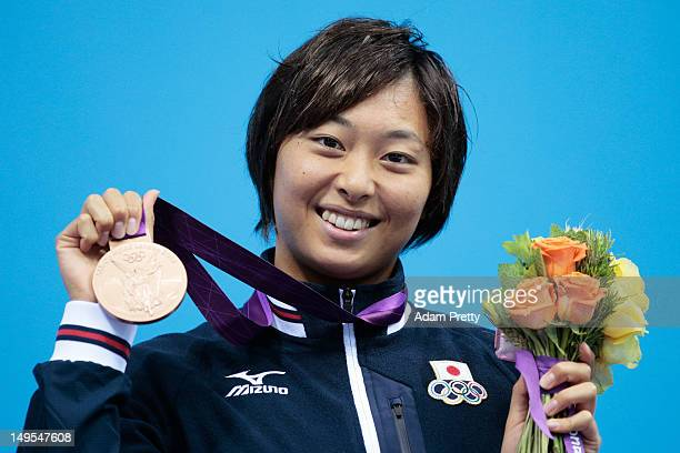 Bronze medalist Satomi Suzuki of Japan celebrate with her medal during the medal ceremony for the Women's 100m Breaststroke on Day 3 of the London...