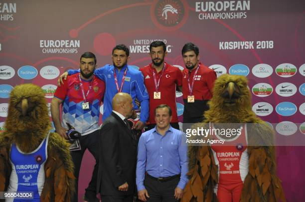 Bronze medalist Selahattin Kilicsallayan of Turkey silver medalist Ilias Bekbulatov of Russia gold medalist Hajj Aliyev and other bronze medalist...