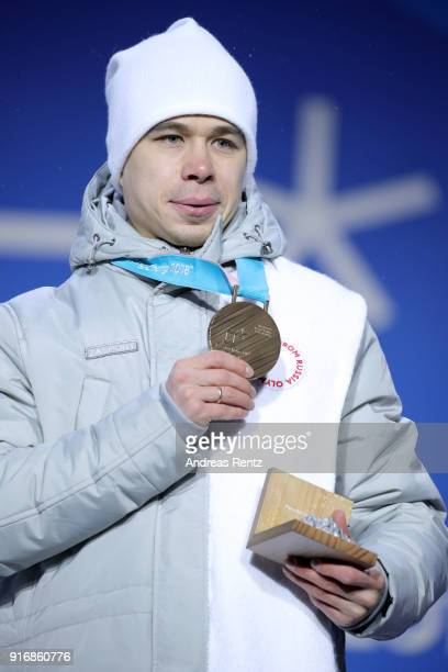 Bronze medalist Semen Elistratov of Olympic Athletes from Russia poses on the podium during the Medal Ceremony for the Men's Short Track 1500m on day...
