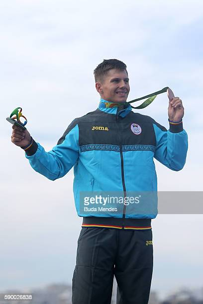 Bronze medalist Serghei Tarnovschi of Moldova celebrates on the podium during the Men's Canoe Single 1000m Final A on Day 11 of the Rio 2016 Olympic...
