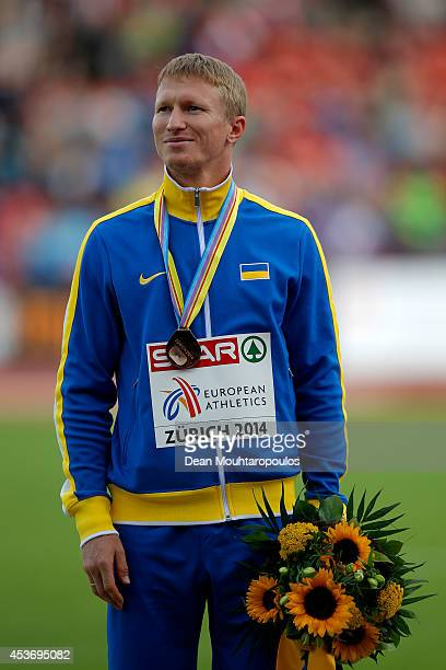Bronze medalist Serhiy Smelyk of Ukraine celebrates on the podium during the medal ceremony for the Men's 200 metres final during day five of the...