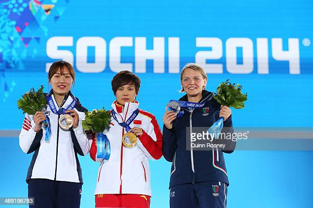 Bronze medalist SeungHi Park of Korea gold medalist Jianrou Li of China and silver medalist Arianna Fontana of Italy celebrate during the medal...
