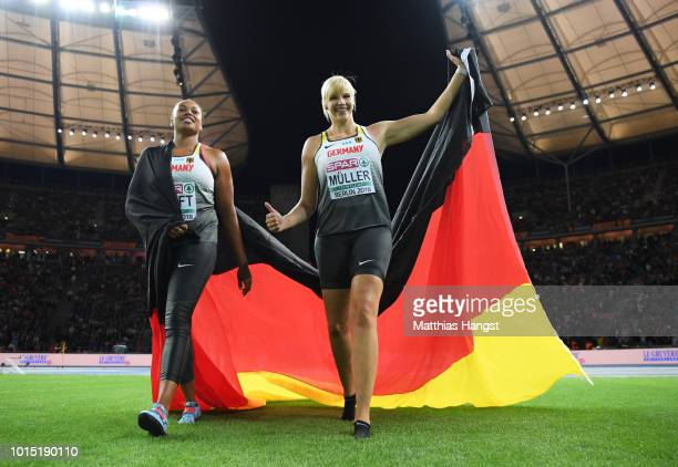 Bronze medalist Shanice Craft of Germany and Silver medalist Nadine Mueller of Germany celebrate after the Women's Discus Throw Final during day five...