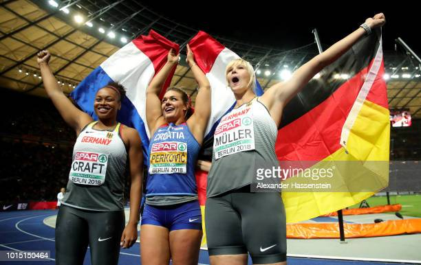 Bronze medalist Shanice Craft of Germany Silver medalist Nadine Mueller of Germany and Gold medalist Sandra Perkovic of Croatia celebrate after the...