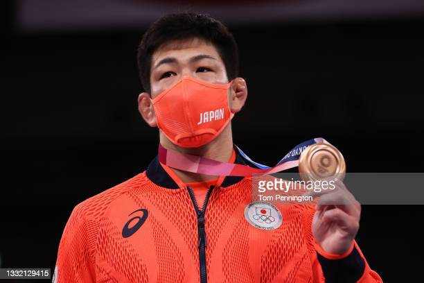 Bronze medalist Shohei Yabiku of Team Japan poses with the bronze medal during the Men's Greco-Roman 77kg medal ceremony on day eleven of the Tokyo...