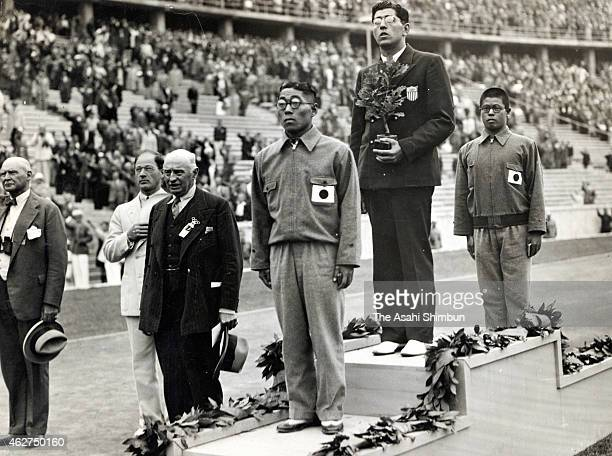 Bronze medalist Shozo Makino of Japan gold medalist Jack Medica of the United States silver medalist Shumpei Uto pose on the podium during the medal...