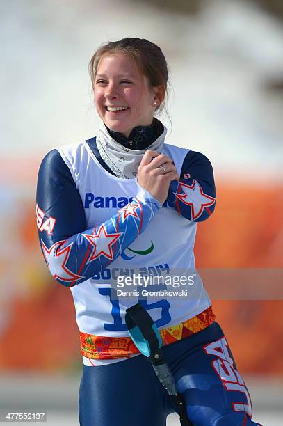 Bronze medalist Solene Stephanie Jallen of USA celebrates during the flower ceremony for the Women's SuperG Standing during day three of Sochi 2014...