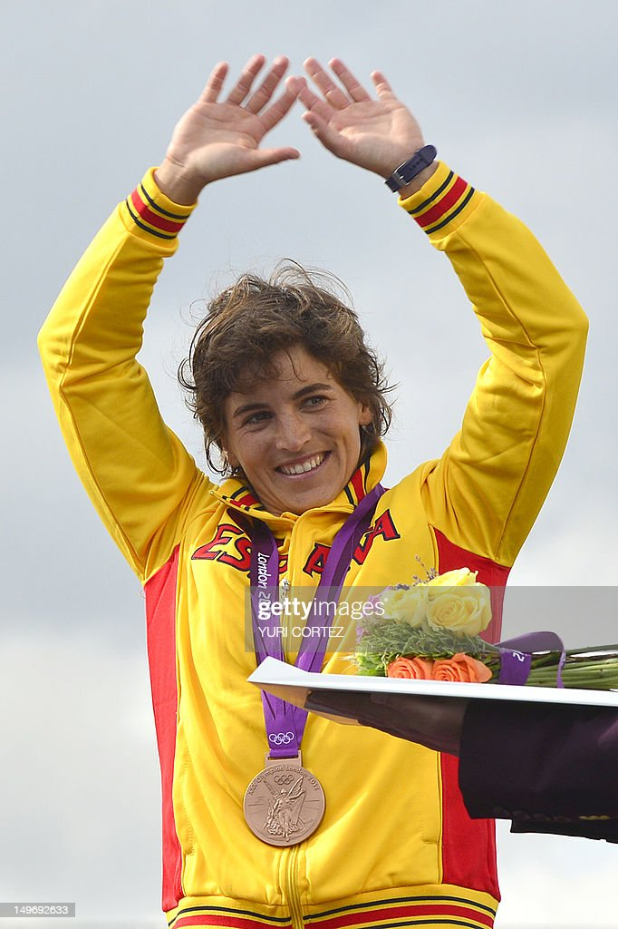 Bronze medalist Spain's Maialen Chourraut celebrates on the podium after the Kayak Single Women's Slalom final at the ' Lee Valley White Water Centre', on August 2, 2012 in London, on day 6 of the London 2012 Olympic Games.
