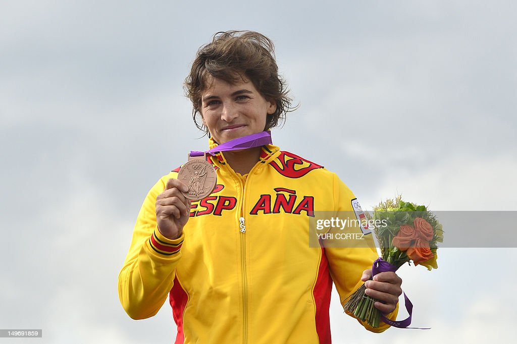 Bronze medalist Spain's Maialen Chourraut poses on the podium after the Kayak Single Women's Slalom final at the ' Lee Valley White Water Centre', on August 2, 2012 in London, on day 6 of the London 2012 Olympic Games.