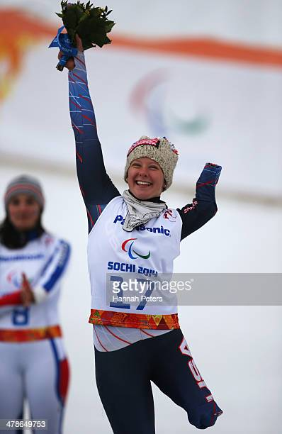 Bronze medalist Stephanie Jallen of the United States celebrates during the flower ceremony for the Women's Super Combined Standing Super G during...