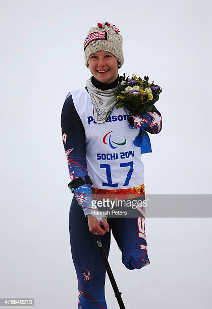 Bronze medalist Stephanie Jallen of the United States poses during the flower ceremony for the Women's Super Combined Standing Super G during day...