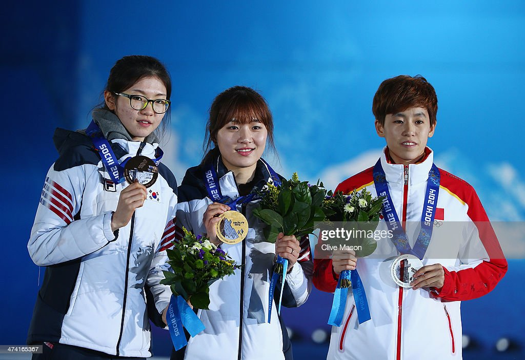 Bronze medalist Suk Hee Shim of South Korea, gold medalist Seung-Hi Park of South Korea and silver medalist Kexin Fan of China celebrate during the medal ceremony for the Short Track Women's 1000m on Day 15 of the Sochi 2014 Winter Olympics at Medals Plaza on February 22, 2014 in Sochi, Russia.
