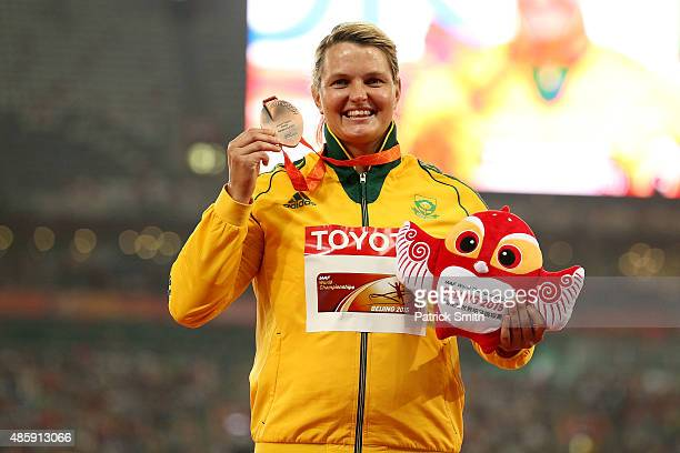Bronze medalist Sunette Viljoen of South Africa poses on the podium during the medal ceremony for the Women's Javelin final during day nine of the...