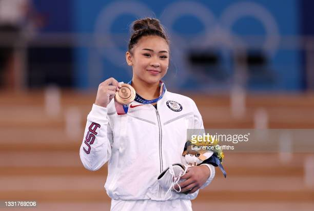 Bronze Medalist Sunisa Lee of Team United States poses with her medal on the podium during the Women's Uneven Bars Final medal ceremony on day nine...