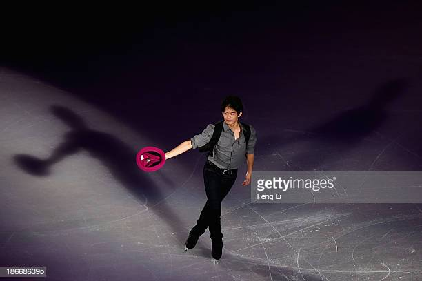 Bronze medalist Takahiko Kozuka of Japan performs during Lexus Cup of China ISU Grand Prix of Figure Skating 2013 at Beijing Capital Gymnasium on...