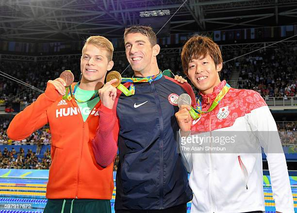Bronze medalist Tamas Kenderesi of Hungary, Michael Phelps of the United States and silver medalist Masato Sakai of Japan pose on the podium during...