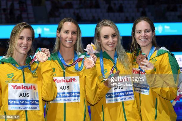 Bronze medalist team Australia celebrate on the podium of the women's 4x100m medley relay final during the swimming competition at the 2017 FINA...