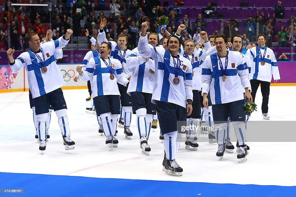 Bronze medalist Teemu Selanne #8 of Finland celebrates with teammates after defeating the United States 5-0 during the Men's Ice Hockey Bronze Medal Game on Day 15 of the 2014 Sochi Winter Olympics at Bolshoy Ice Dome on February 22, 2014 in Sochi, Russia.