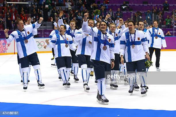 Bronze medalist Teemu Selanne of Finland celebrates with teammates after defeating the United States 5-0 during the Men's Ice Hockey Bronze Medal...
