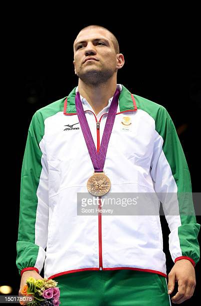 Bronze medalist Tervel Pulev of Bulgaria celebrates on the podium during the medal ceremony for the Men's Heavy Boxing final bout on Day 15 of the...