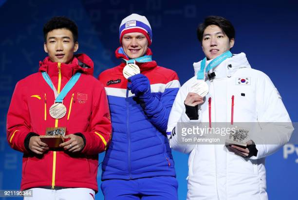 Bronze medalist Tingyu Gao of China gold medalist Havard Lorentzen of Norway and silver medalist Min Kyu Cha of Korea celebrate during the medal...