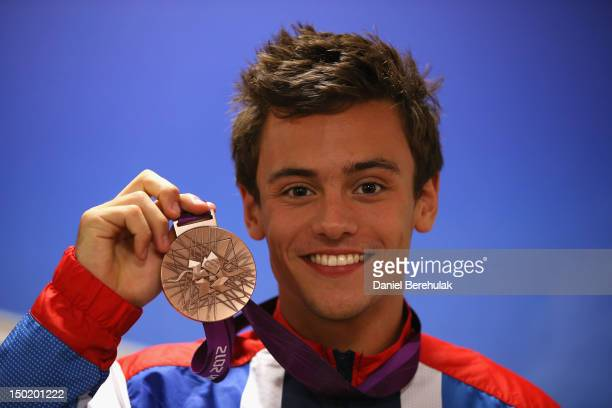 Bronze medalist Tom Daley of Great Britain poses with his medal for the Men's 10m Platform Diving as he attends a TEAM GB Press Conference during Day...