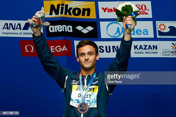 Bronze medalist Tom Daley of Great Britain poses with the medal won in the Men's 10m Platform final on day nine of the 16th FINA World Championships...