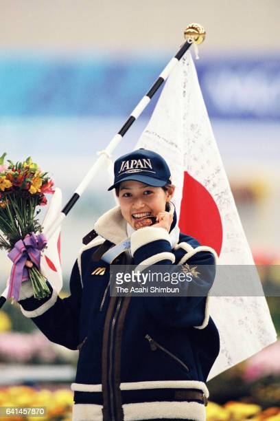 Bronze medalist Tomomi Okazaki of Japan celebrates on the podium at the medal ceremony for the Speed Skating Women's 500m during day seven of the...