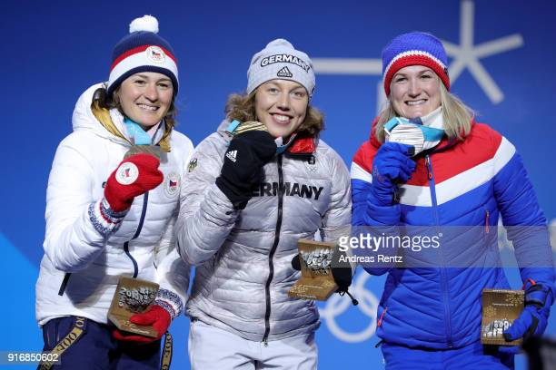Bronze medalist Veronika Vitkova of the Czech Republic gold medalist Laura Dahlmeier of Germany and Silver medalist Marte Olsbu of Norway pose during...